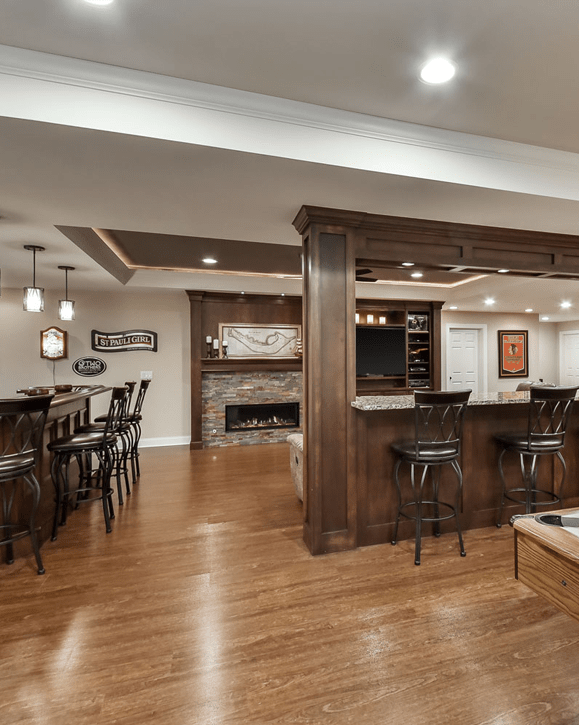 Furnished basement into a living area with addition of kitchenette